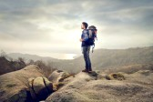 17602381-young-man-with-backpack-in-the-mountains