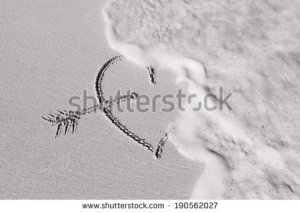 stock-photo-heart-on-the-beach-getting-wash-out-broken-heart-190562027
