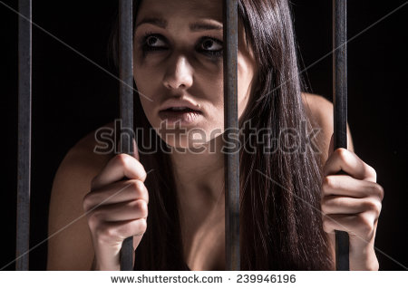 stock-photo-young-woman-looking-from-behind-bars-trapped-woman-behind-iron-bars-239946196