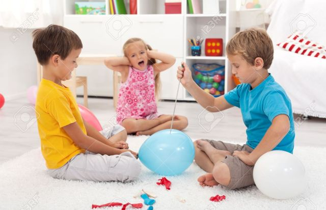 10480650-Kids-popping-balloons-in-their-room-fearing-the-blast-focus-on-the-right-side-boy-Stock-Photo