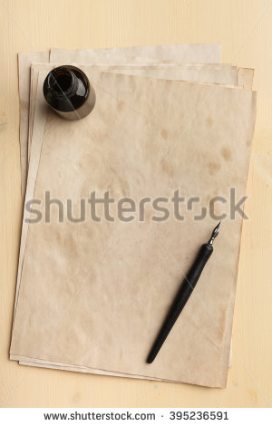stock-photo-ink-pen-and-inkpot-on-a-pile-of-old-paper-395236591.jpg